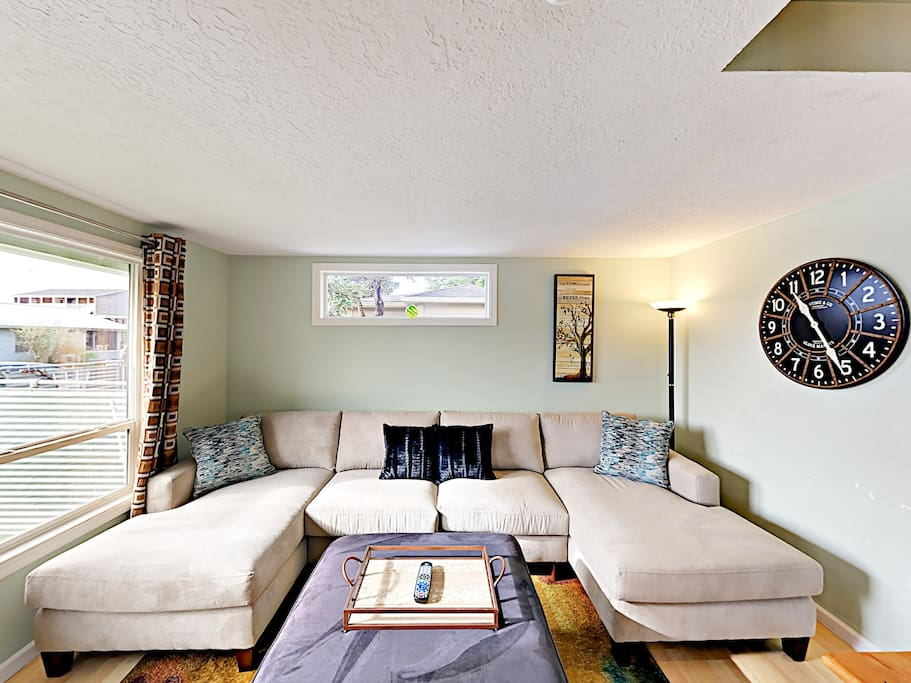 Kick back on the large sectional sofa in the main living area.