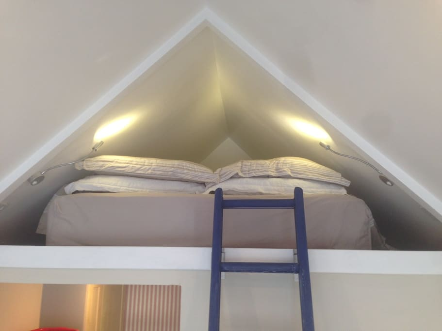 King sized bed at mezzanine level