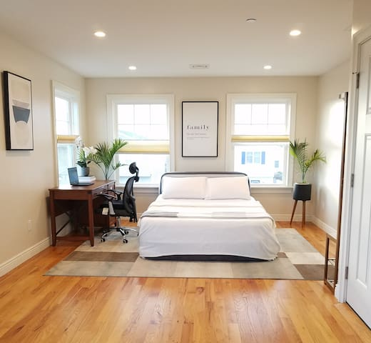 Home Office/Airbed Sleeping Area - Work in zen calmness or seamlessly transition to a 4th sleeping area using a portable queen air bed with headboard support and  cotton bedding.