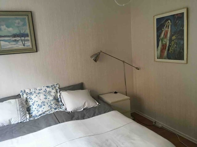Bedroom with double bed. There is room for a single bed.