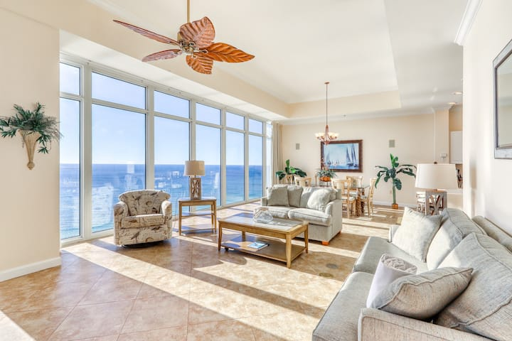 Beautiful beachfront condo with floor to ceiling windows and shared pool access!