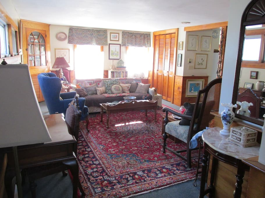 Living room is spacious and has lots of natural light with windows on 3 sides.