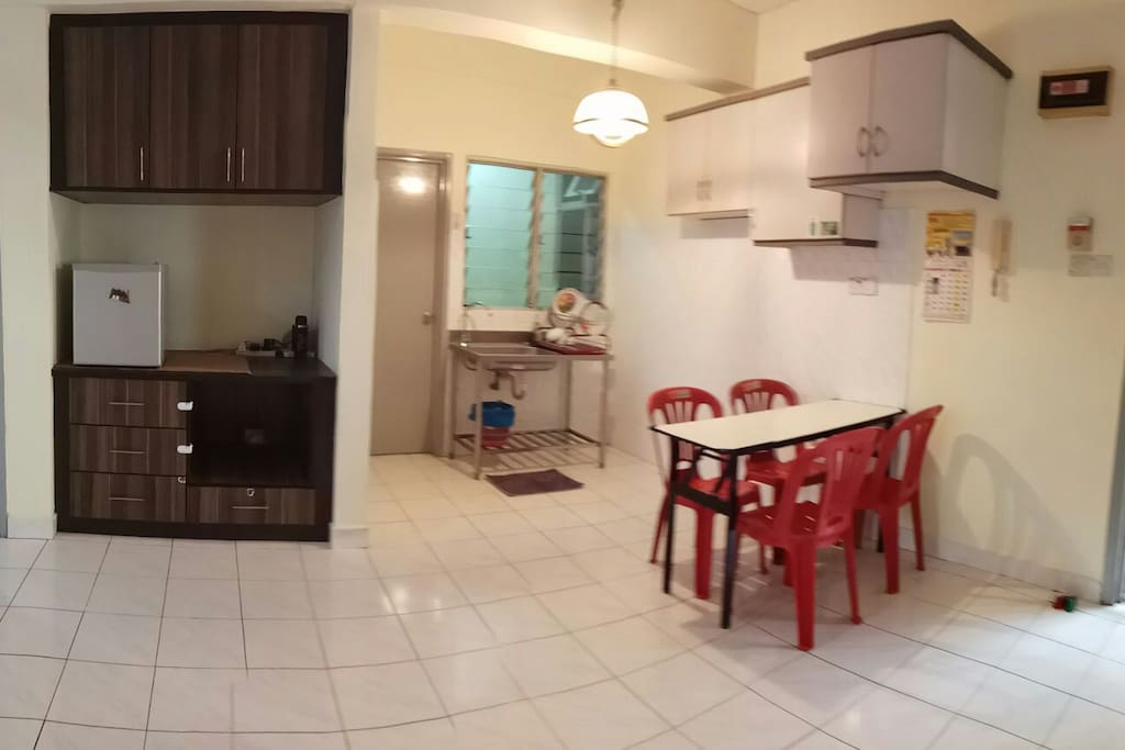 simple dining area with kitchenette,sink, mini fridge. however, no stove/ cooker is provided.