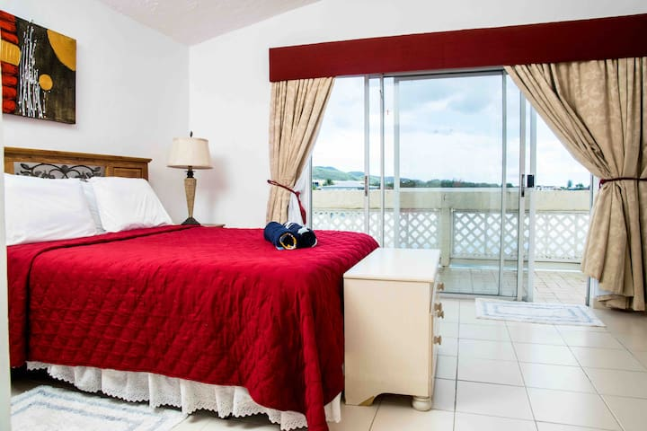 Master bedroom with view of waterway