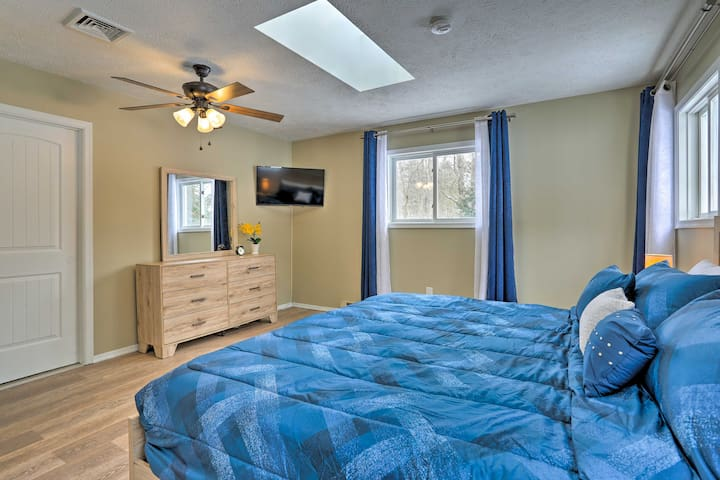 Huge king master bedroom with large windows, skylight and smart TV