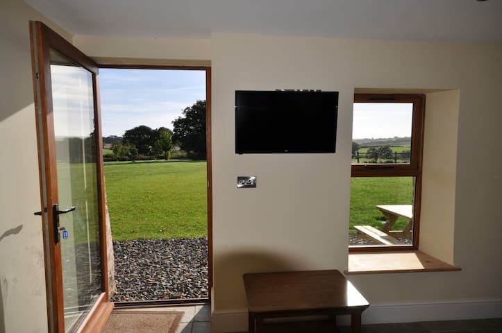 Living Room with fantastic outside views and front garden