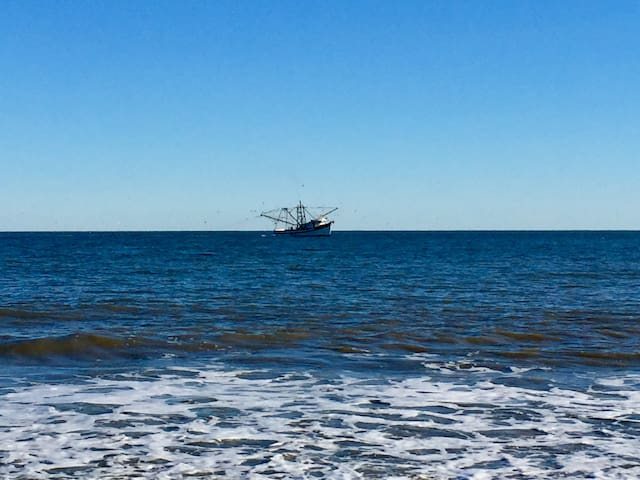 Shrimp boat in front of Folly Field Beach