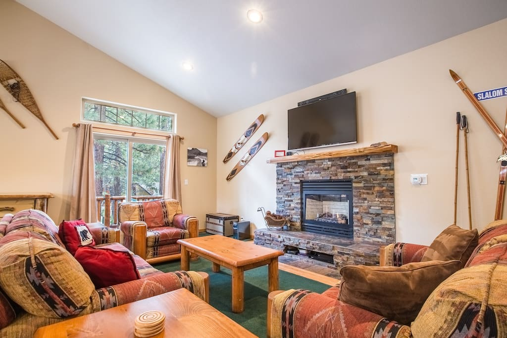 Surround yourself in comfort: seating for 6 around the fireplace, sliding door to deck, large HDTV with Apple TV