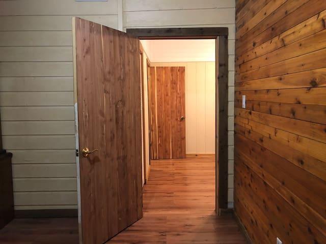 Doorway from Bedroom 1 into Bedroom 2 (you pass through bedroom 1 to get to bedroom 2)