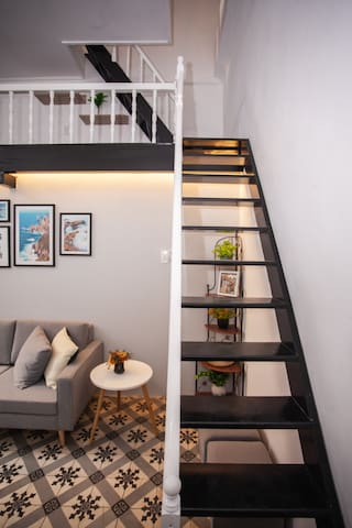 Stairs to mezzanine and bedroom