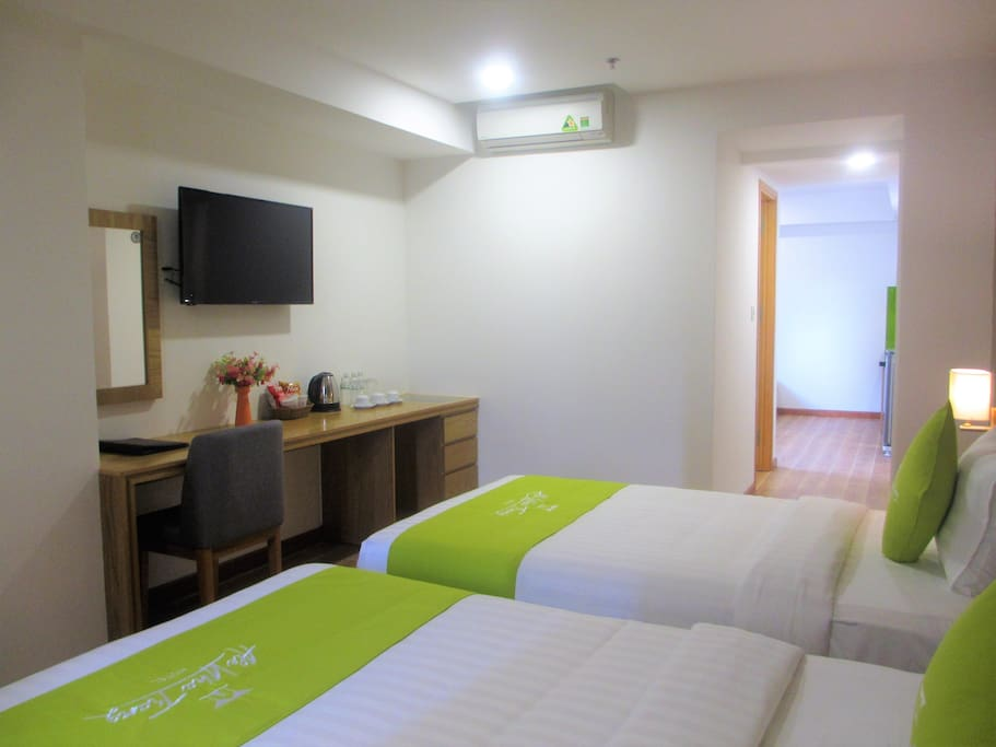 Bed room and living room combined with kitchen, accommodated with separated TV and Salon.