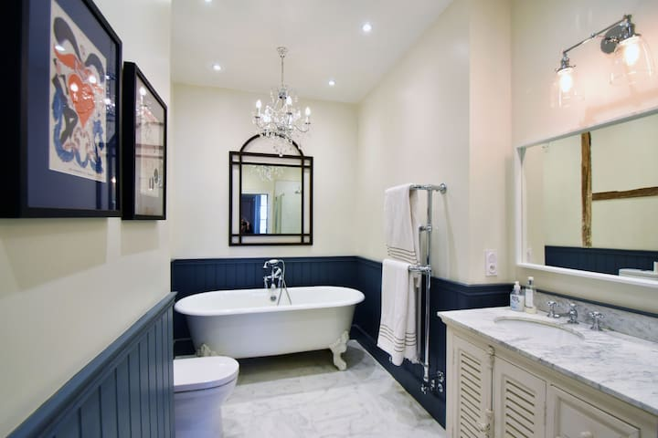 En-suite bathroom with claw foot tub and separate shower.