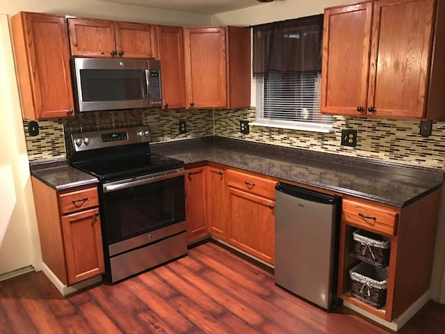 Kitchen: stove, beverage fridge, microwave.