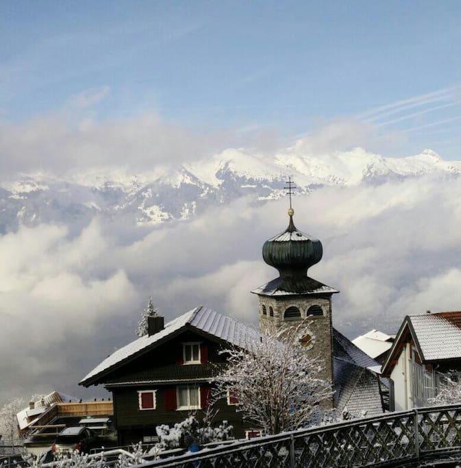 Snow powdered village of Triesenberg in winter.