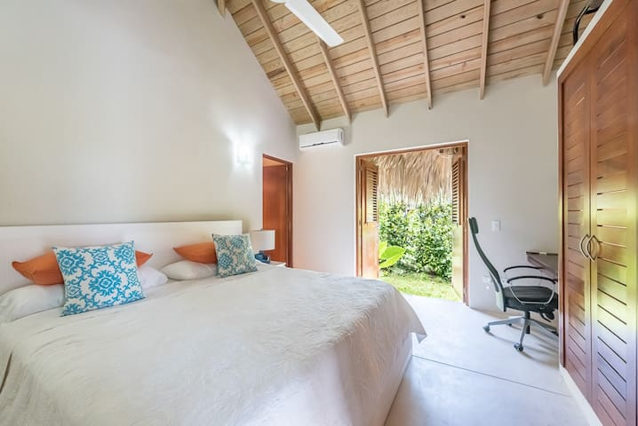 Master bedroom with king bed and private bathroom