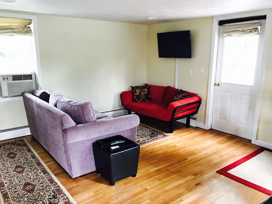 Couch opens to queen bed and futon is a single person futon. Apartment can sleep up to 7 people.