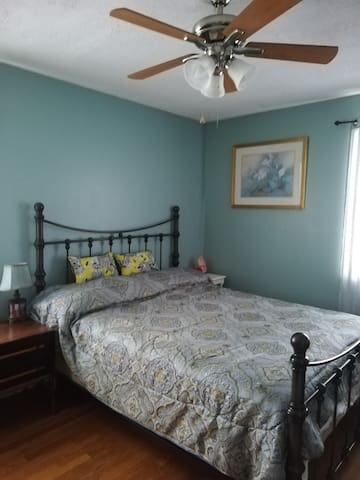 Bedroom with queen bed and private half bath