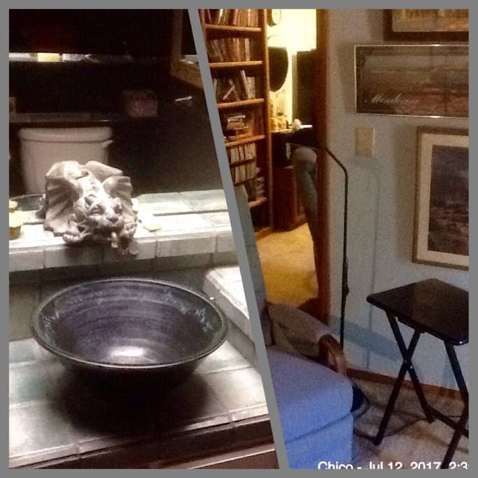Gargoyle faucet, private bath, tub and shower. Comfortable chair, books you can borrow