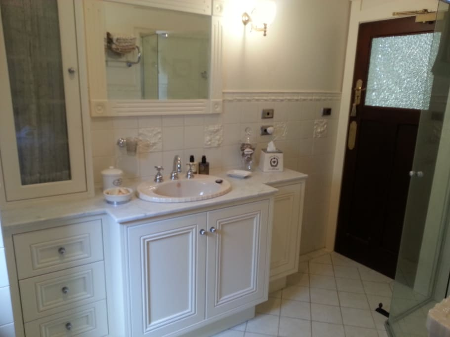 Marble top bathroom with shower