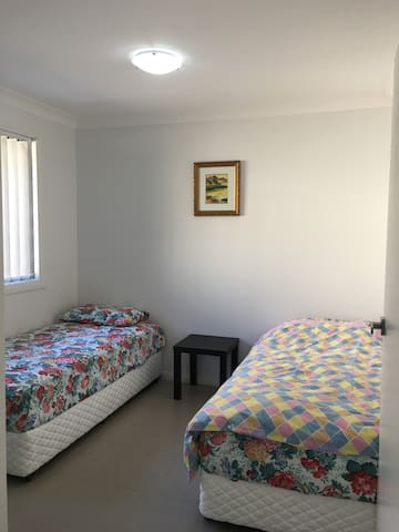This is the second bedroom with 2 single beds