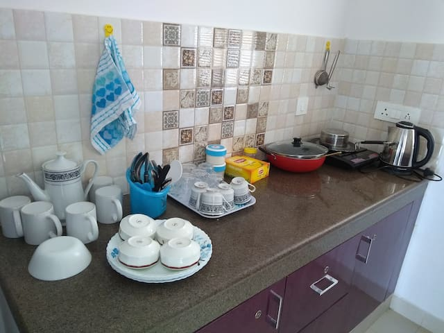 Induction stove , electric water jug, tea, sugar, creamer, biscuit  all necessary utensils, cutlery and crockery provided