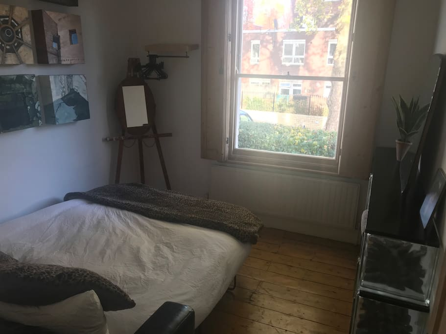 The studio - bedroom - with wooden shutters, a wood floor and somewhere to hang your clothes