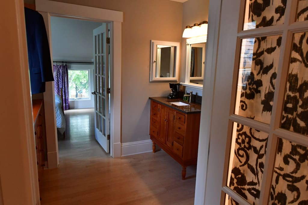 This is the middle room of the three-space suite. The entrance into this suite from the main house is just the right of the vanity.