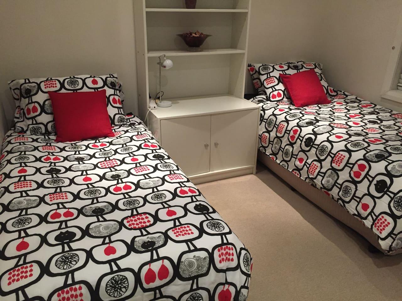 Two single beds, built in wardrobe, lots of light.