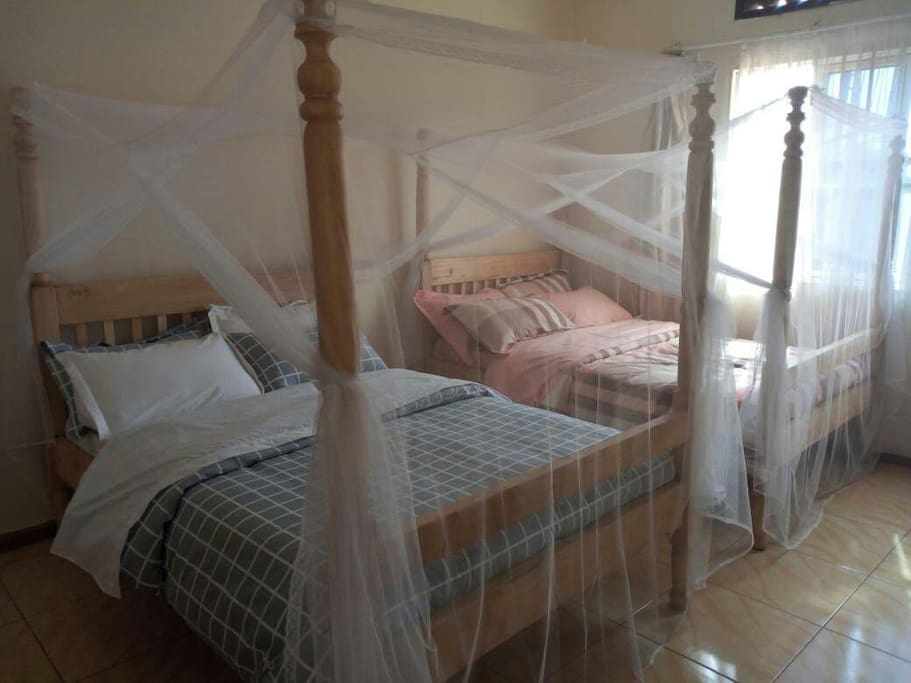Both beds with Mosquito nets
