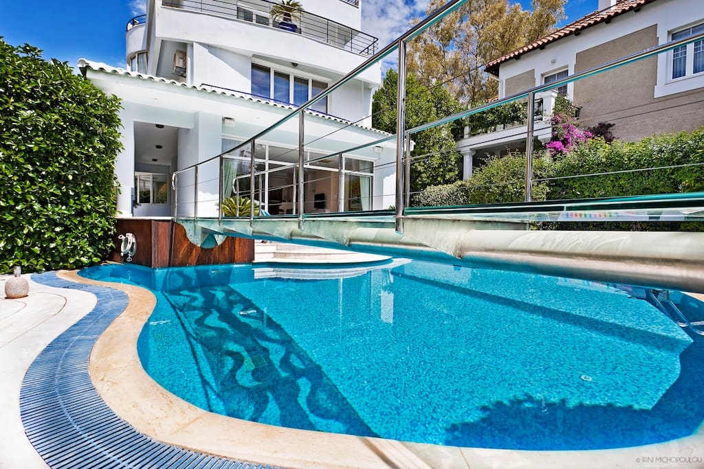 Outside Area - Big garden with an amazing oval shaped pool. Step back and enjoy the pool & sun-beds under the sun during the hot summer days.