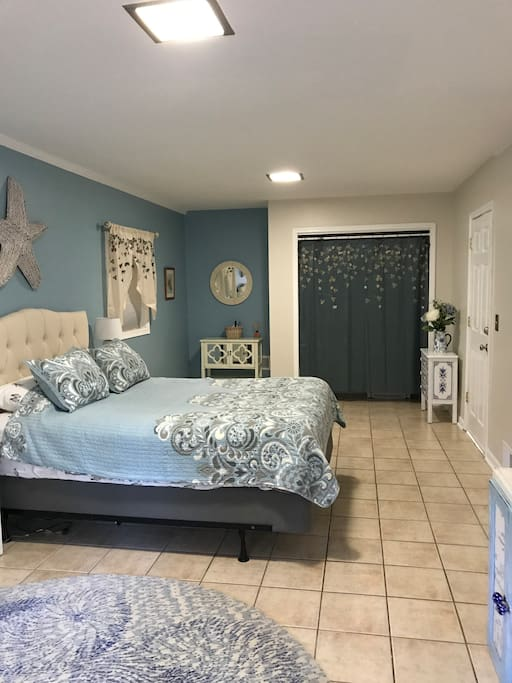 Main living area with small dresser and closet with extra linens