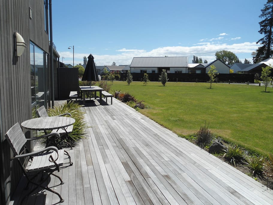 Sunny deck for relaxing while you enjoy the lovely setting