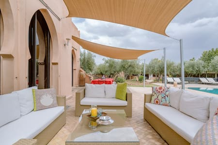 Explore Marrakesh from a Poolside Villa on an Olive Grove