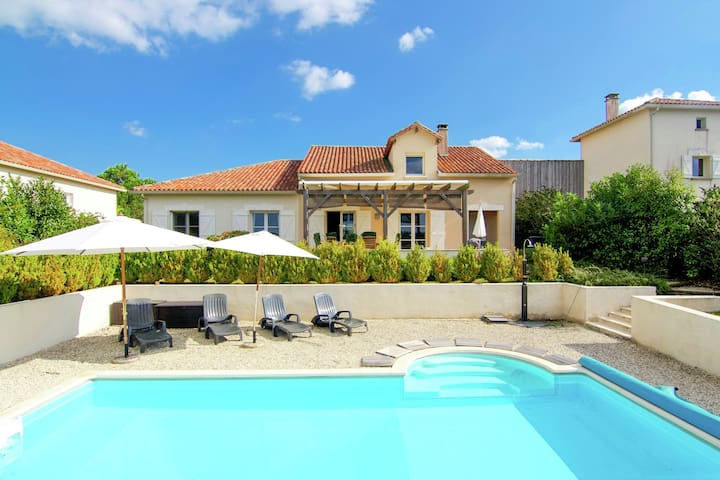 Luxury villa with heated pool overlooking a challenging 18-hole golf course.