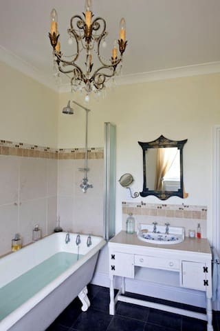 The 100 year old bath with 3 taps en-suite to the bedroom that can be a double or two singles