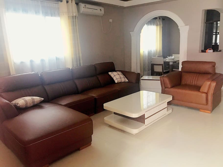 House no 1: Modern type lounge with comfortable leather couches and coffee table and side tables