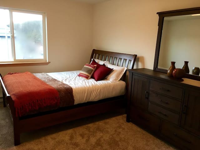 Second room with queen bed.