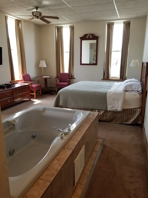 Quaint room with jacuzzi tub and downtown views