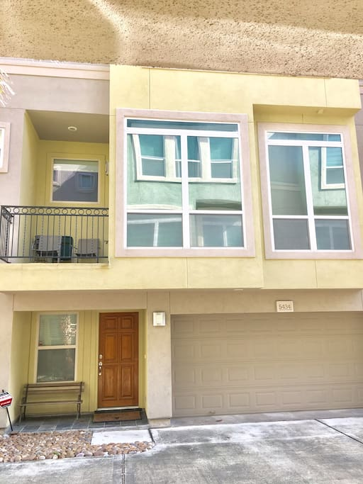 Three story townhouse with 2 car garage and balcony