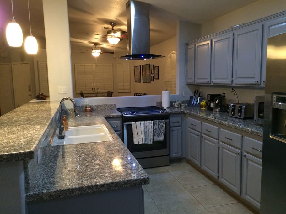 Granite counters, stainless steel appliances, breakfast bar