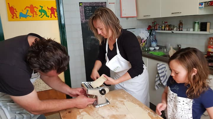 Beautiful family making tagliatelle!