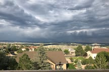 Storms last around 30 minutes then beautiful blue skies return. View from back porch