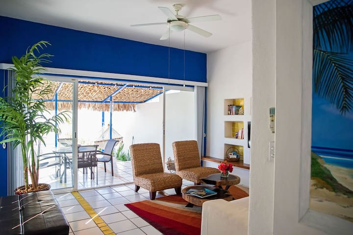 The bright and breezy living room opens up onto the courtyard.