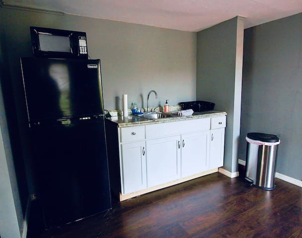 Kitchen with burner, microwave, fridge, and coffee maker