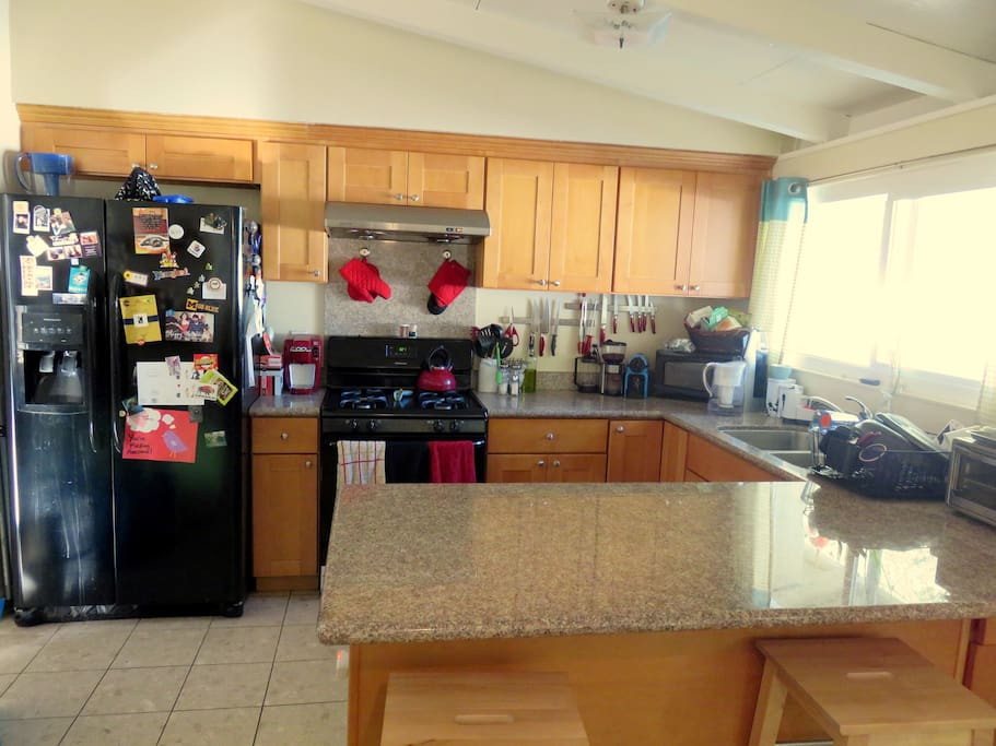 Expansive kitchen with plenty of counter space.  Fulfills all of your cooking needs!