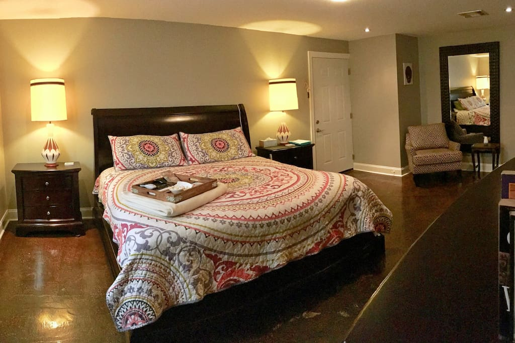 """Master bedroom. This is the space offered for renting. King size super comfortable bed, 65"""" TV, Apple TV, Firestick included. Private bath and separate entrance."""