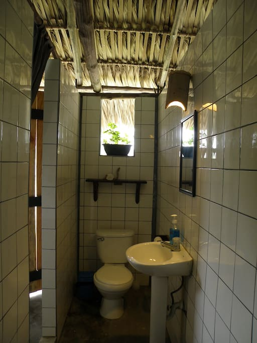 Private bathroom with new appliances and shelving to store your personal belongings.