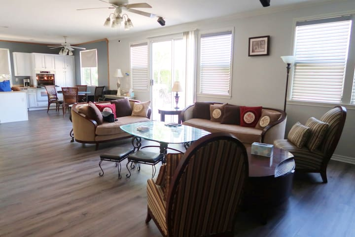 Newly updated wood flooring throughout the home on September 2018