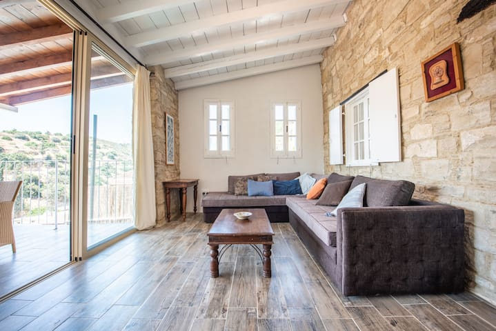 Comfortable living room, with access to the large terrace