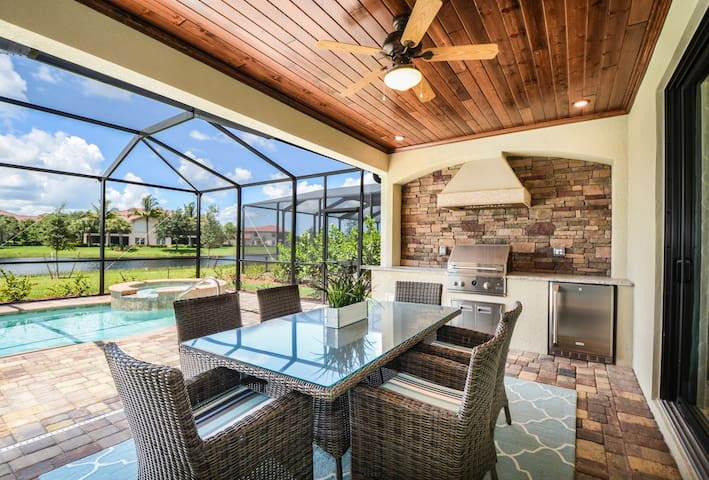 Take advantage of the outdoor kitchen and indulge at the outdoor dining table.